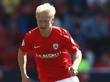 Barnsley's David Perkins in action against Wigan during their Championship match on August 3, 2013