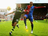 Jonathan Walters of Stoke City is challenged by Adlene Guedioura of Crystal Palace during the Barclays Premier League match on January 18, 2014