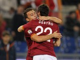 Roma's Mattia Destro celebrates with teammate Adem Ljaijc after scoring the opening goal against Livorno Calcio during their Serie A match on January 18, 2014