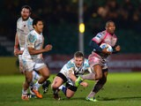 Oyonnax's Silvere Tian breaks through the Worcester Warriors defence during their Challenge Cup match on January 18, 2014