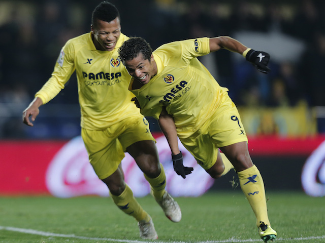 Villarreal's Mexican forward Giovani Dos Santos (R) celebrates his goal with Villarreal's Nigerian forward Ikechukwu Uche during the Spanish league football match on January 13, 2014