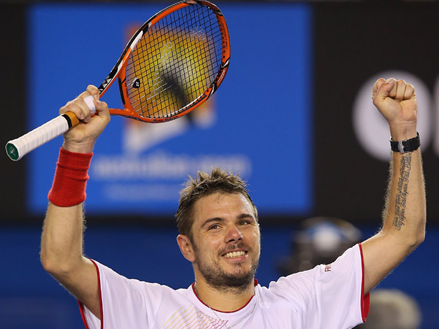 Stanislas Wawrinka celebrates after his win over Tommy Robredo in their Australian Open fourth round match on January 19, 2014