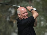 Andy Gray, former international footballer and broadcaster, in action during the Pro Am prior to the start of the Commercial Bank Qatar Masters at Doha Golf Club on January 21, 2014