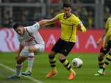 FC Augsburg's forward Raul Bobadilla and Dortmund's midfielder Nuri Sahin vie for the ball during the German first division Bundesliga football match Borussia Dortmund vs FC Augsburg in the German city of Dortmund on January 25, 2014