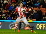Manchester United's French defender Patrice Evra beats Stoke City's Irish midfielder Glenn Whelan to score the second goal during the English League Cup Quarter-Final football match between Stoke City And Manchester United at Britannia Stadium in Stoke on