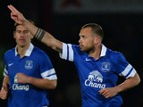 Everton's Dutch defender John Heitinga celebrates scoring Everton's third goal during the English FA Cup fourth round football match against Stevenage on January 25, 2014