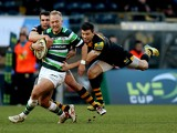 Shane Geraghty of London Irish is tackled by Tommy Bell of Wasps during the LV=Cup match between London Wasps and London Irish at Adams Park on January 25, 2014
