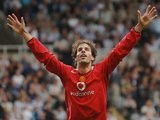 Ruud van Nistelrooy celebrates scoring against Newcastle United on August 28, 2005.