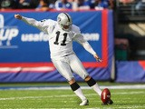 Sebastian Janikowski of the Oakland Raiders in action against the New York Giants during their game at MetLife Stadium on November 10, 2013