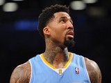 Wilson Chandler #21 of the Denver Nuggets looks on during the second quarter against the Brooklyn Nets at Barclays Center on December 3, 2013
