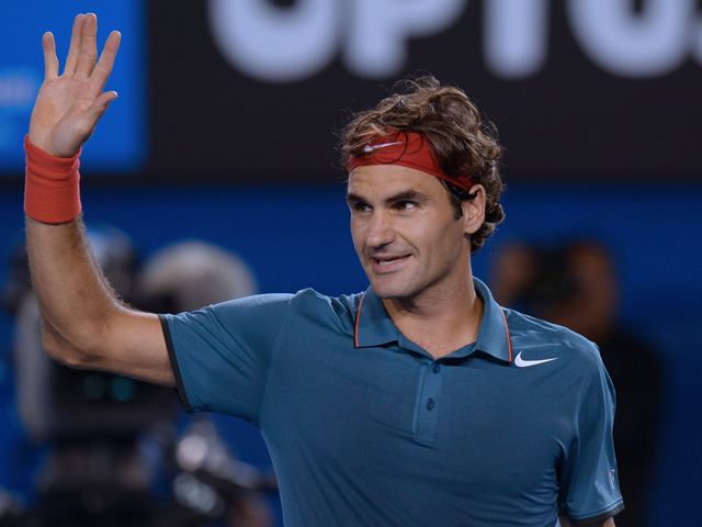 Switzerland's Roger Federer celebrates after victory in his men's singles match against France's Jo-Wilfried Tsonga on day eight of the 2014 Australian Open tennis tournament in Melbourne on January 20, 2014