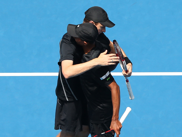 Eric Butorac of the United States and Raven Klaasen of South Africa celebrate winning their third round doubles match against Mike Bryan of the United States and Bob Bryan of the United States during day eight of the 2014 Australian Open at Melbourne Park