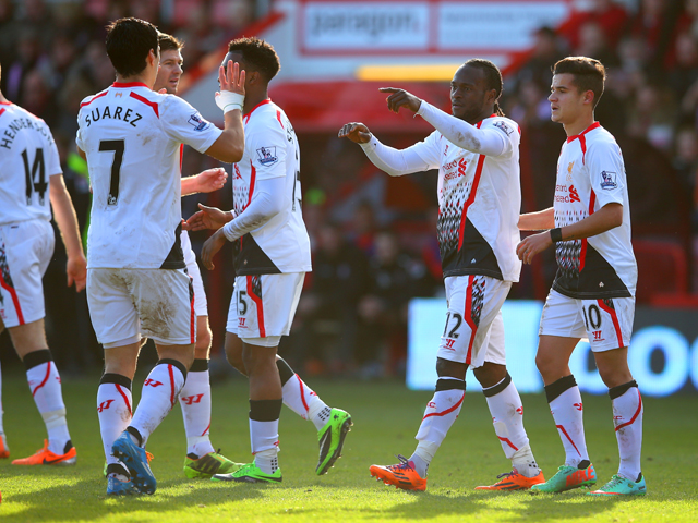 Victor Moses of Liverpool points at Luis Suarez of Liverpool as he celebrates scoring the opening goal with his team mates during the FA Cup Fourth Round match between Bournemouth and Liverpool at Goldsands Stadium on January 25, 2014