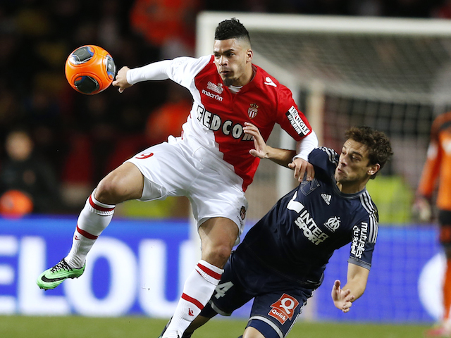 Monaco's French forward Emmanuel Riviere (L) vies for the ball with Marseille's Brazilian defender Lucas Mendes (R) during the French L1 football match on January 26, 2014
