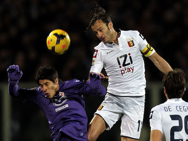 Facundo Ronacaglia of ACF Fiorentina fights for the ball with Alberto Gilardino of Genoa CFC during the Serie A match on January 26, 2014