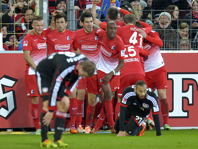 Freiburg's players celebrate after teammate midfielder Felix Klaus scored the winning goal for their 3-2 victory in the German first division Bundesliga football match SC Freiburg vs Bayer 04 Leverkusen in Freiburg, southwestern Germany, on January 25, 20