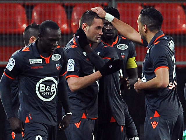 Lorient's French defender Gregory Bourillon (C) is congratulated by teammates after scoring a goal during the French L1 football match against Valenciennes on January 25, 2014