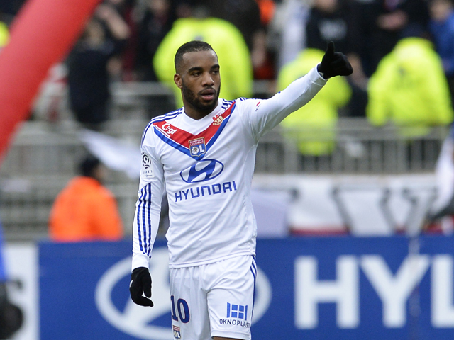 Lyon's French forward Alexandre Lacazette celebrates after scoring a goal during the French L1 football match Olympique Lyonnais (OL) vs Evian Thonon Gaillard (ETG) on January 26, 2014