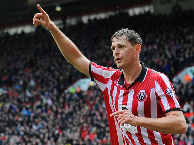 Sheffield United's English forward Chris Porter celebrates after scoring the opening goal during the FA Cup fourth round football match between Sheffield United and Fulham at Bramall Lane in Sheffield, England, on January 26, 2014