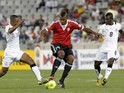 Libya's player Elhouni (C) vies for the ball with Ghana's players Jordan Opoku (R) and Joshua Tijani (L) during the African Nations Championship final on February 1, 2014