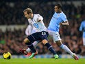 Man City's Fernandinho and Tottenham's Christian Eriksen in action during their Premier League match on January 29, 2014