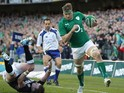 Ireland's no. 8 Jamie Heaslip evades a tackle from Scotland's full back Stuart Hogg during the Six Nations international rugby union match between Ireland and Scotland at the Aviva Stadium in Dublin on February 2, 2014