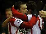 Sunderland's Adam Johnson celebrates with teammate Fabio Borini after scoring the opening goal against Stoke during their Premier League match on January 29, 2014