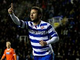 Reading's Adam Le Fondre celebrates after scoring his team's second goal against Blackpool during their Championship match on January 28, 2014