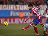 Atletico Madrid's Brazilian midfielder Diego scores during the Spanish league football match Club Atletico de Madrid vs Real Sociedad at the Vicente Calderon stadium in Madrid on February 2, 2014