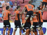 Henrique of the Roar and team mates celebrate after he scores a goal during the round 17 A-League match between Brisbane Roar and the Central Coast Mariners at Suncorp Stadium on February 2, 2014