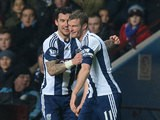 West Brom's Chris Brunt celebrates with teammate Liam Ridgewell after scoring the opening goal against Aston Villa during their Premier League match on January 29, 2014