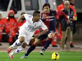 Daniele Dessena (R) of Cagliari and Anderson of Fiorentina compete for the ball during the Serie A match on February 1, 2014