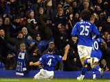 Everton's Northern Irish midfielder Darron Gibson (L) celebrates scoring the opening goal of the English Premier League football match between Everton and Manchester City on January 31, 2012