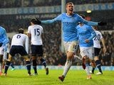 Manchester City's Edin Dzeko celebrates after scoring his team's third goal against Tottenham during their Premier League match on January 29, 2014