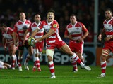 Ryan Mills of Gloucester feeds a pass during the International match between Gloucester and Japan at Kingsholm Stadium on November 12, 2013