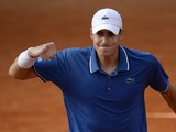 USA's John Isner celebrates his victory over Argentina's Carlos Berlocq at the end of their French Tennis Open first round match at the Roland Garros stadium in Paris, on May 27, 2013