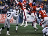 Punter Ray Guy #8 of the Los Angeles Raiders kicks the ball away against defensive backs Daniel Hunter #25, Tony Lilly #22 and linebacker Simon Fletcher #73 of the Denver Broncos during the game at Mile High Stadium on December 8, 1985
