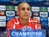 Olympiacos' Algerian player Rafik Djebbour attends a press conference on October 23, 2012