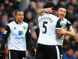 Robert Snodgrass of Norwich City celebrates with Sebastien Bassong after a goal during the Barclays Premier League match against Cardiff City on February 1, 2014
