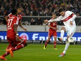 Stuttgart's Vedad Ibisevic scores the opening goal against Bayern Munich during their Bundesliga match on January 29, 2014
