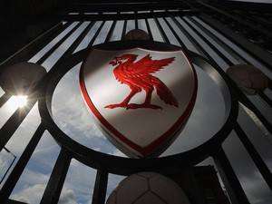 The Liverpool Football Club emblem is displayed on the gates of Anfield Stadium on September 17, 2012
