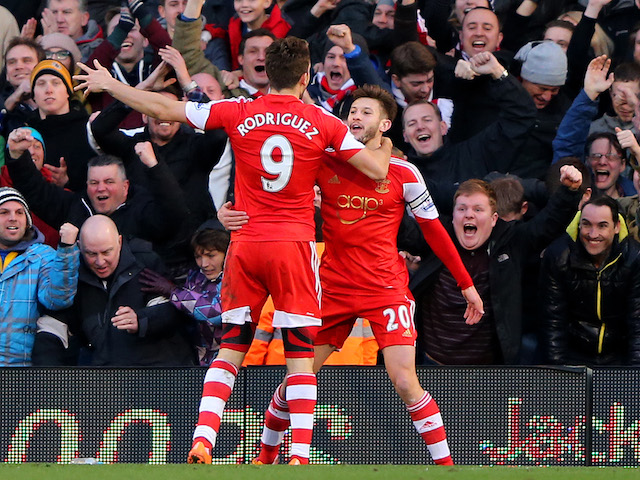 Adam Lallana (R) of Southampton celebrates with team-mate Jay Rodriguez of Southampton after scoring the opening goal during the Barclays Premier League match against Fulham on February 1, 2014