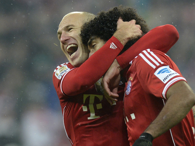 Bayern Munich's Dutch midfielder Arjen Robben and Bayern Munich's Brazilian defender Dante celebrate after the fourth goal for Munich during the German first division Bundesliga football match FC Bayern Munich vs Eintracht Frankfurt at the Allianz Arena i