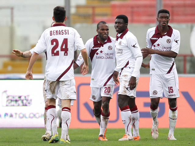 Innocent Emeghara of Livorno celebrates with his team-mates after scoring the opening goal during the Serie A match between Calcio Catania and AS Livorno Calcio at Stadio Angelo Massimino on February 2, 2014