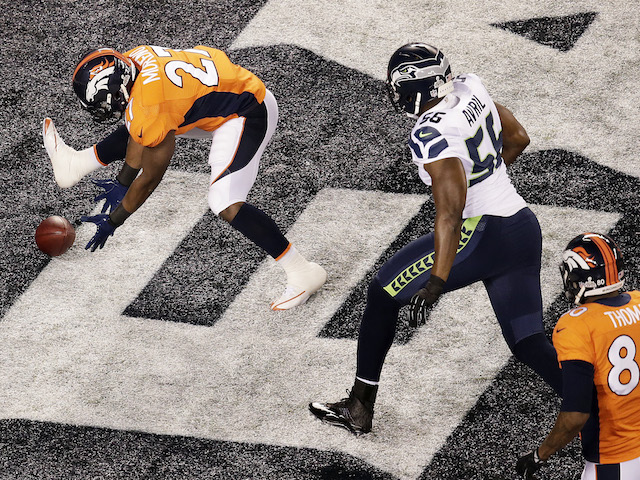 Running back Knowshon Moreno of the Denver Broncos recovers the ball in the endzone for a safety against the Seattle Seahawks on February 2, 2014