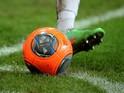 A football player kicks a ball