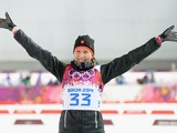 Gold medalist Anastasiya Kuzmina of Slovakia celebrates during the flower ceremony after the Women's 7.5 km Sprint during day two of the Sochi 2014 Winter Olympics at Laura Cross-country Ski & Biathlon Center on February 9, 2014