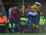 Thomas Ince of Crystal Palace celebrates scoring the first goal with his team-mates and their mascot Pete the Eagle during the Barclays Premier League match between Crystal Palace and West Bromwich Albion at Selhurst Park on February 8, 2014