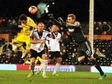 Fulham's English goalkeeper David Stockdale (R) comes to claim a cross during the English FA Cup fourth round replay football match against Sheffield United on February 4, 2014