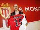 Monaco L1 football club's newly-recruited Bulgarian forward Dimitar Berbatov poses with his new jersey during a press conference on February 4, 2014
